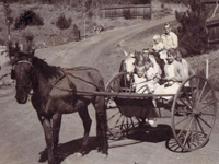 The Cole Family with Cracker pulling the cart and Christine with brother on Snowball